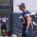 Image of Sean Lee and other Cowboys Practicing football