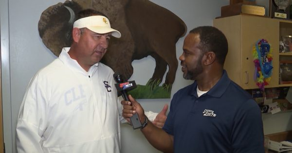 Image of Marcus Floyd interviewing Coach Jared Johnston