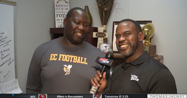 Image of Marcus Floyd interviewing East Central Football Coach Joe Hubbard