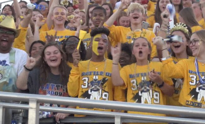 Image of Clemens students shouting for their team