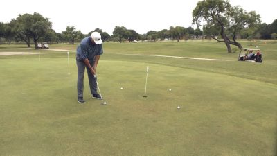 Image of Andy Everett doing around the world putting drill on the green