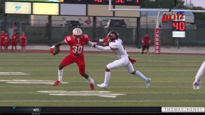 Image of Judson Rockets football player blocking Wagner Thunderbird player