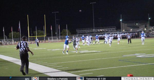 Image of High School football team running on the field