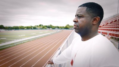 Image of Rodney Williams looking at football field from bleachers