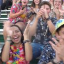 Image of high school fans cheering towards camera