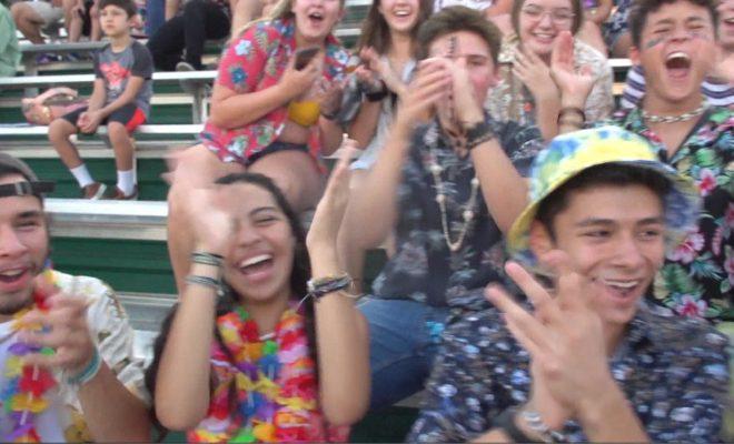 Image of high school fans cheering towards camera