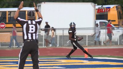 Image of a Steele knight football player making a touchdown