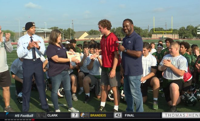 Image of Marcus Floyd presenting Player of the Week award to Reagan's Travis Stehle
