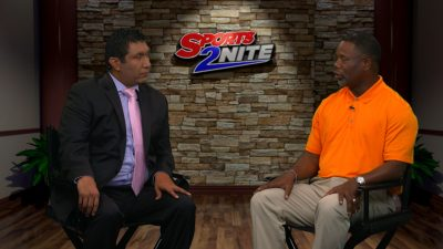 Image of Frank Wilson sitting down in studio with Hector Ledesma talking football