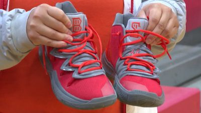 """Image of close up shot of Judson Rockets girls basketball team's custom show for """"Bryce Strong"""""""