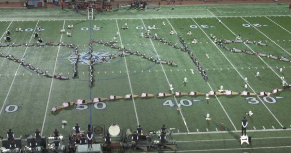 Image of Lee high school band spelling out the word Days on the field