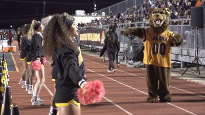 Image of Brennan Bears cheer squad and mascot dancing