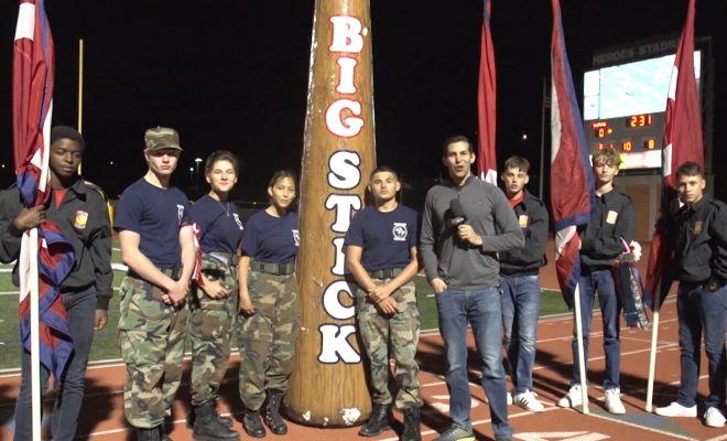 Image of Mike Lefko with Roosevelt students and their big stick
