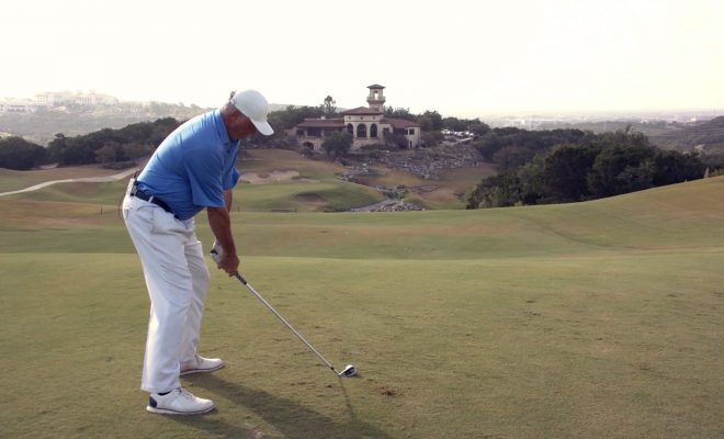 Image of Andy Everett about to tee off from high elevation