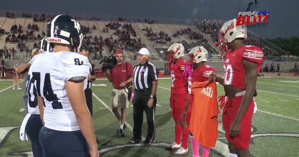 Image of Judson and Smithson Valley football captains meeting in middle of field for coin toss