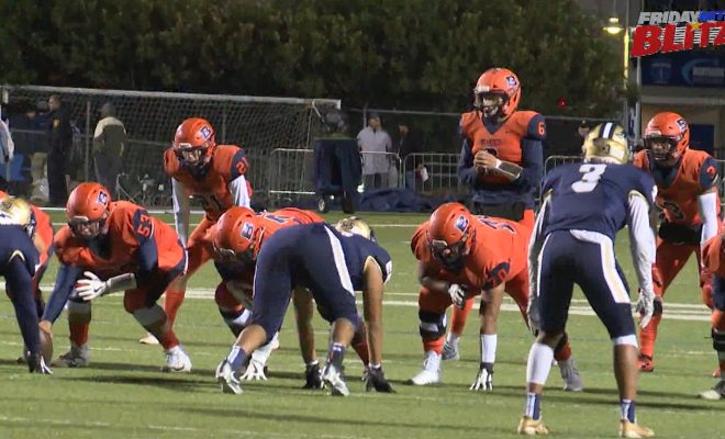 Image of Brandeis high school vs O'Connor football team on the field