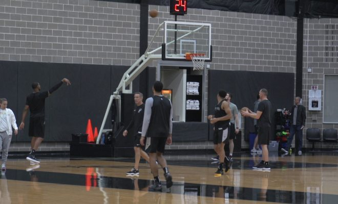 Image of San Antonio Spurs during shooting drills at their practice facility