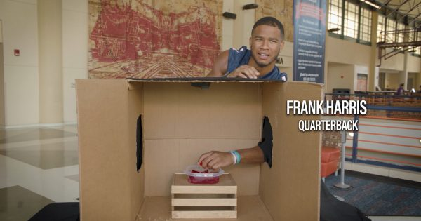 Image of UTSA Football quarterback Frank Harris guessing what's inside the box, which is jello