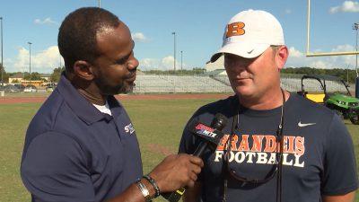 Image of Marcus Floyd interviewing Brandeis Head Football coach David Branscom