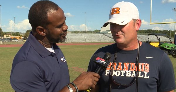 Image of Marcus Floyd interviewing Brandeis Head Football coach David Branscom
