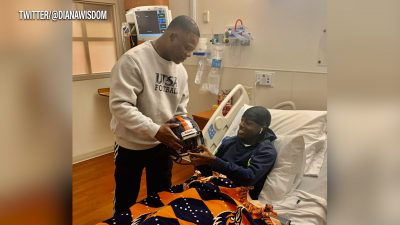 Image of Frank Wilson visiting Bryce Wisdom at the hospital