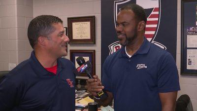 Image of Marcus Floyd interviewing Veterans Memorial Football coach Richard Mendoza