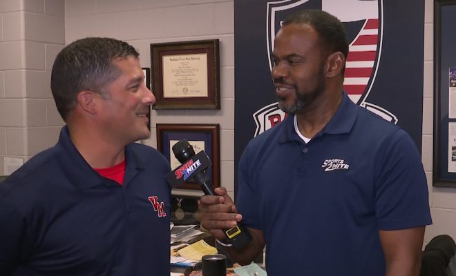 Image of Marcus Floyd interviewing Veterans Memorial Football coach Richard Mendoza
