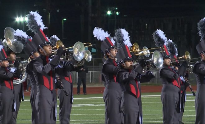 Image of Judson Rockets band performing on the field