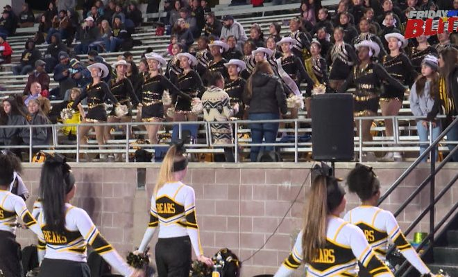 Image of Brennan Bears cheer and band at football stadium