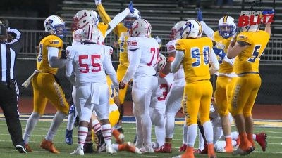 Image of Judson Rockets and Clemens Buffaloes players on the football field