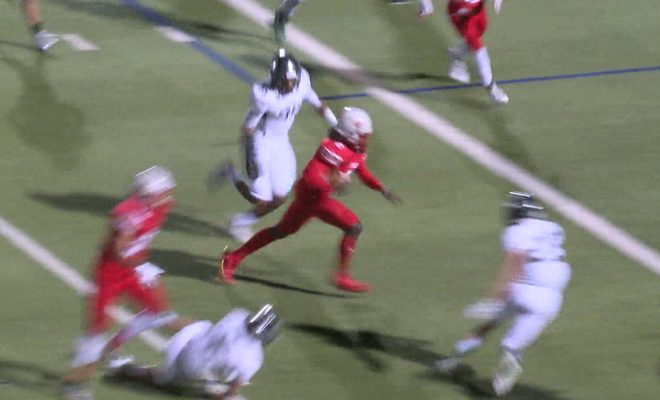 Image of Judson football player running to end zone passing defense