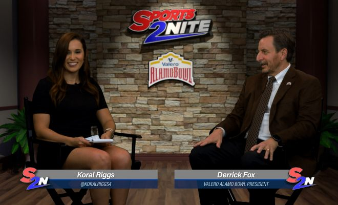Image of Koral and Derrick Fox sitting on set talking Alamo Bowl