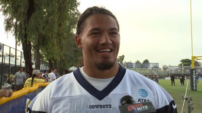 Image of Cowboys Guard Xavier Su'a-Filo getting interviewed