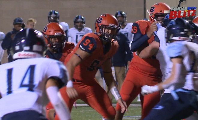 Image of Brandeis Broncos and Johnson Jaguars on the football field playing football