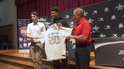 Image of Devin Grant getting honored with all-American bowl jersey