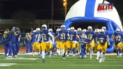 Image of Clemens Football team running out onto the field