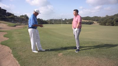Image of Andy Everett and Josh Brown on a golf course talking
