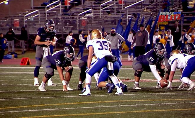 Image of Boerne Champion football team playing against Alamo Heights on the field