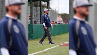 Image of Niko Gonzalez on the baseball field sideline as a coach