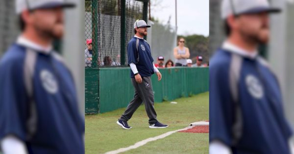 Image of Niko Gonzalez on the baseball field sideline as a coach