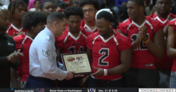 Image of high School football player receiving an award