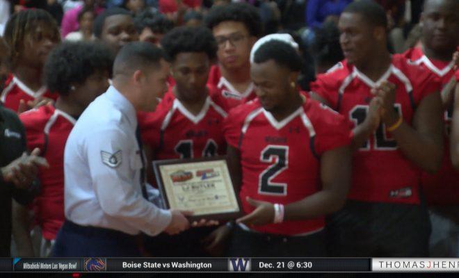 Image of high School football player receiving an award
