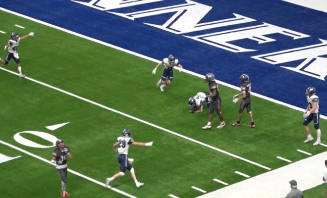 Image of Clemens Buffaloes playing against Brandies Broncos on the Alamodome football field during playoffs