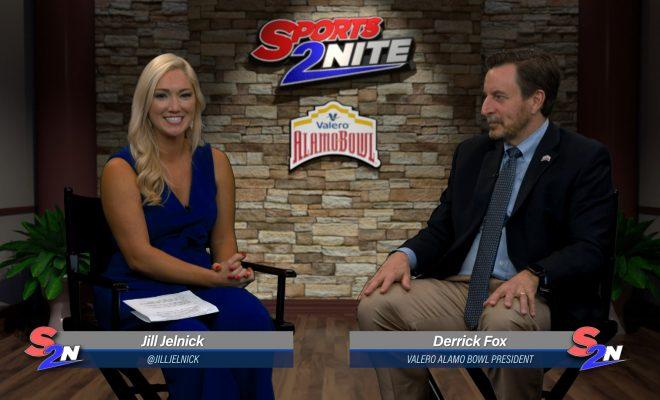 Image of Jill and Derrick Fox sitting on set talking Alamo Bowl
