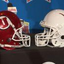 Image of Utah Utes Helmet facing Texas Longhorns helmet on table after team announcement
