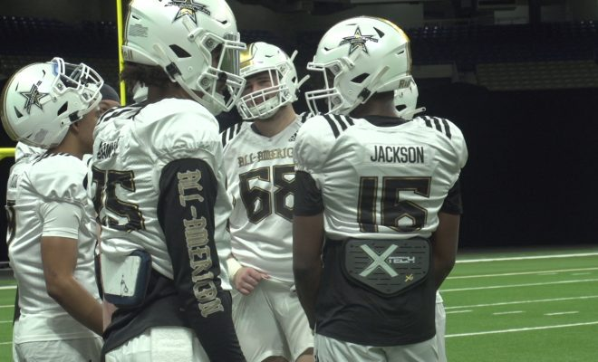 Image of high school football players in huddle
