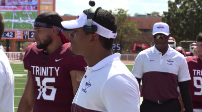 Image of Trinity Coach looking at players during practice