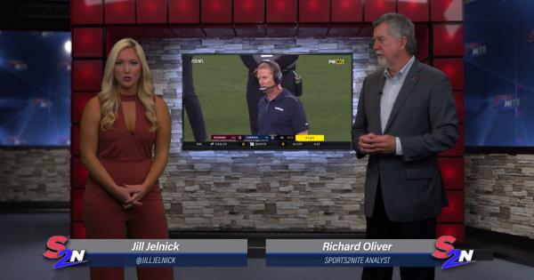 Image of Jill Jelnick and Richard Oliver on set talking Dallas Cowboys