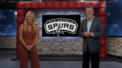 Image of Jill Jelnick and Richard Oliver on set talking Spurs basketball