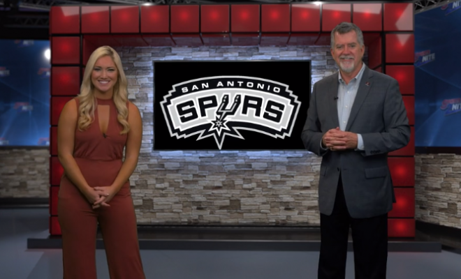 Image of Jill Jelnick and Richard Oliver on set talking Spurs basketball